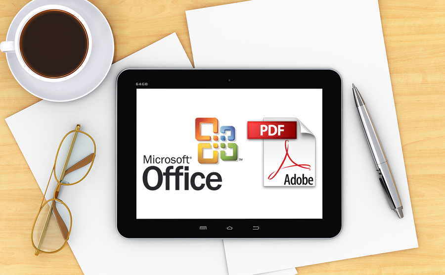 Destop with office items, coffee and a computer device with Microsoft Office and Abode logos