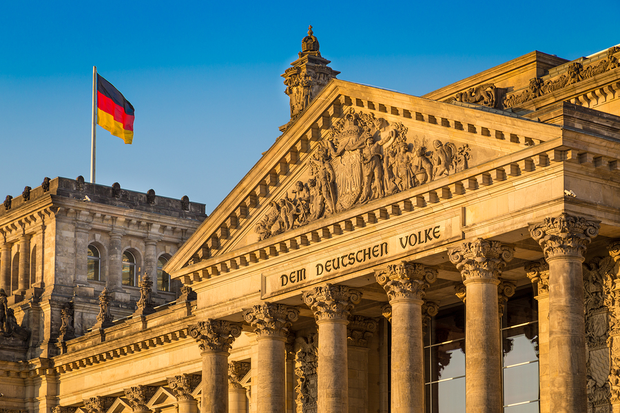 Reichstag building in Berlin, Germany with German flag symbolizing German translations services